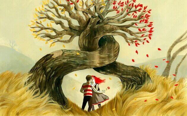 Pareja besándose entre árboles