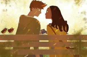 Pareja enamorada sentada en un banco