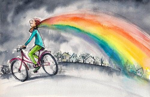 Mujer con arco iris animándote a alcanzar tus sueños