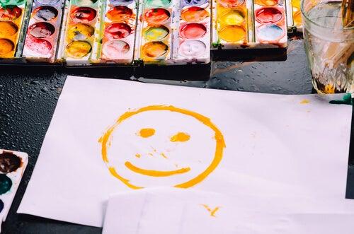 Cara feliz pintada para animarte a lograr el control de tu vida