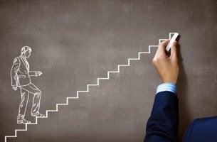 Hombre subiendo escalera con voluntad