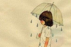 Niña con paraguas simbolizando el efecto chubasquero