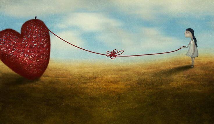 Chica unido a un corazón con un hilo fruto del amor no correspondido