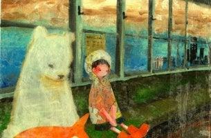 Niño y oso sentados