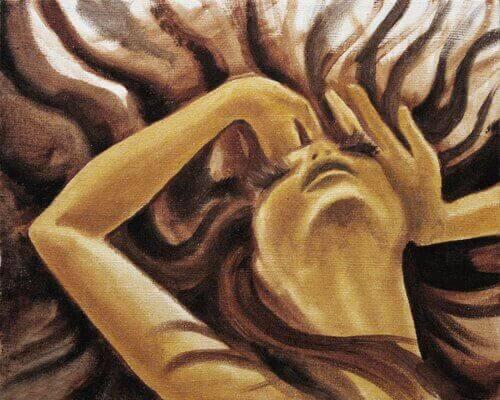 Mujer con angustia agarrándose la cabeza