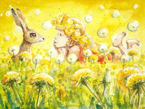 Niña mirando un conejo en el campo