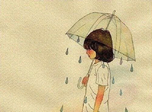 Niña con paraguas simbolizando tristeza