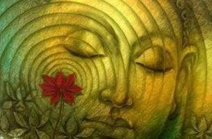 Cara con los ojos cerrados y una flor