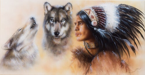 Dos lobos junto a un indio