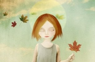 Chica triste con una hoja de un árbol en la mano