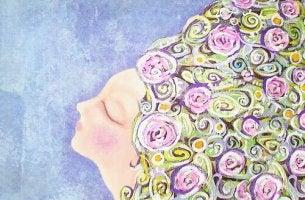 Mujer con los ojos cerrados y el cabello lleno de flores