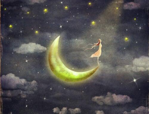 Mujer soñando en la luna