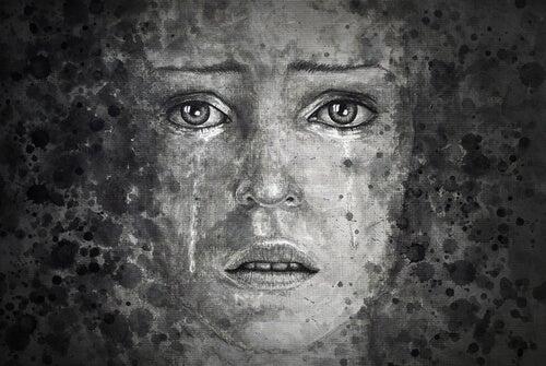 Mujer llorando en el pozo de la deseperación