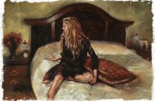 Mujer en la cama con intoxicación emocional