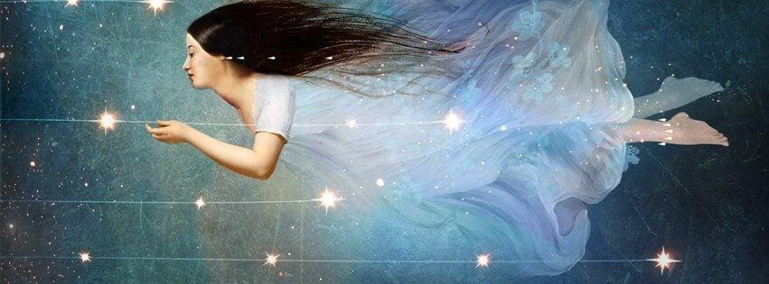 Mujer volando entre estrellas