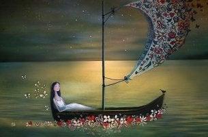 Mujer en una barca pensando en su pasado emocional