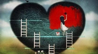 Niña pintando un corazón