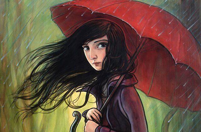 Chica con un paraguas rojo mientras llueve