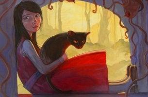 Chica con un vestido rojo y un gato entre sus brazos