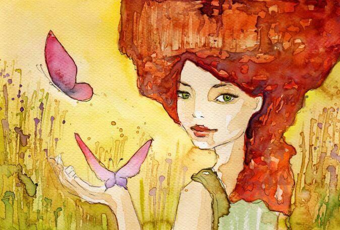 Mujer con el pelo rojo con mariposas en la mano