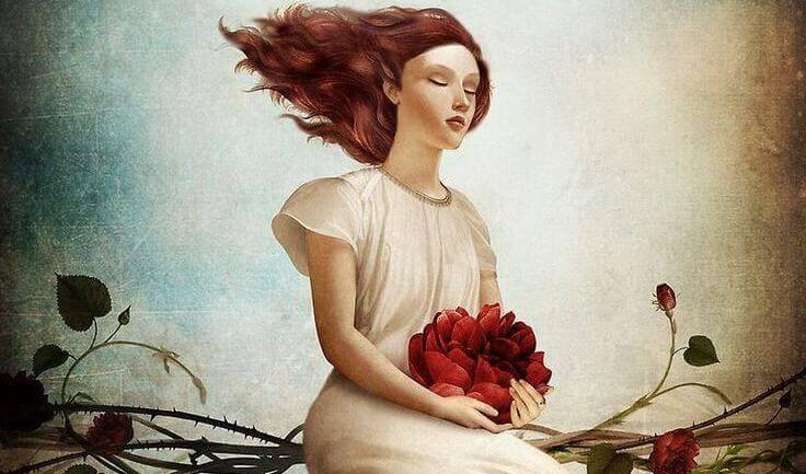 Mujer con flores en la mano