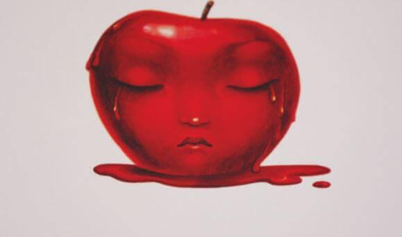 Manzana roja con una cara triste dibujada