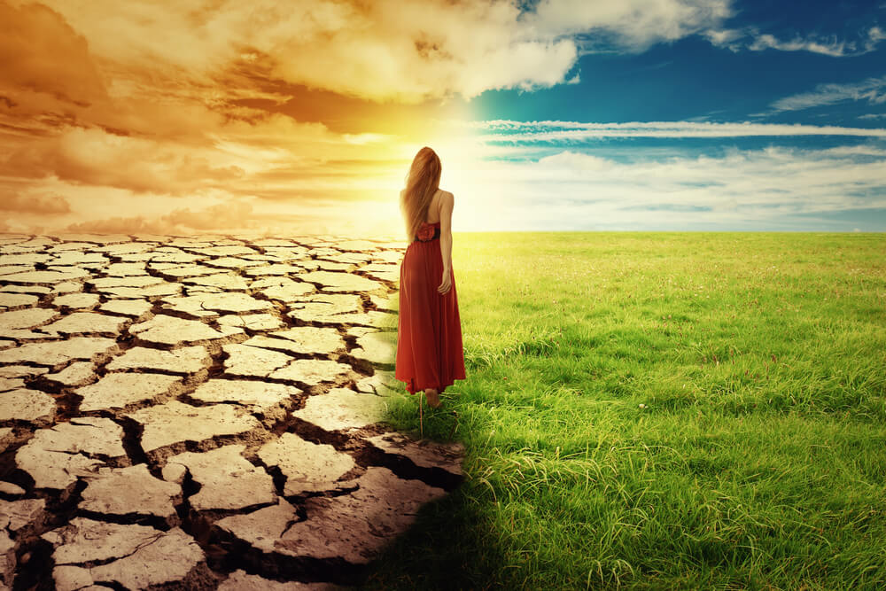 woman between dry and fertile land
