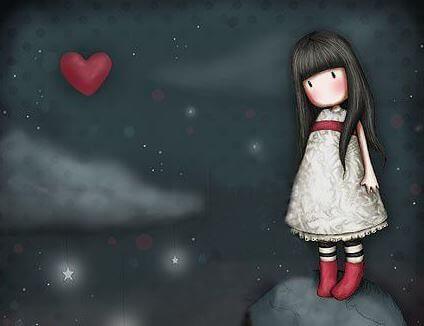 Niña mirando un corazón queriendo enamorarse