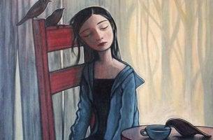 Chica sentada con expresión de tristeza