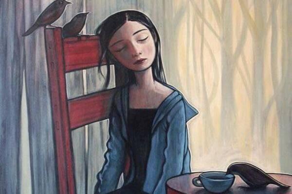 Chica sentada con expresión triste