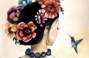 Mujer de espaldas observando el vuelo de un pájaro con una corona de flores en el pelo