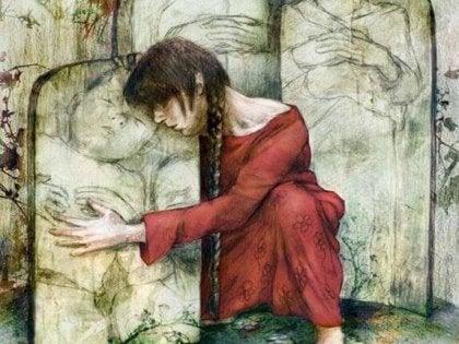Mujer deprimida abrazándose a un cuadro