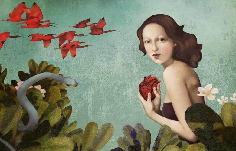 Mujer conun corazón en la mano simbolizando amor