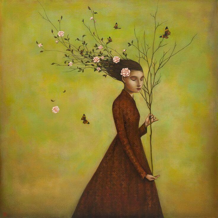 Mujer con árbol sin hojas