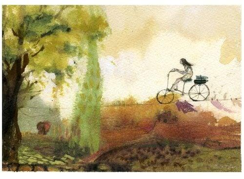 Niña en bicicleta e equilibrio