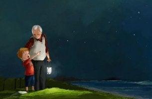 Nieto y abuelo mirando las estrellas