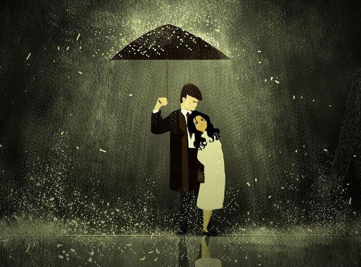 Pareja bajo la lluvia con un paraguas