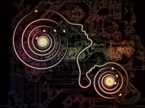 Silueta de cabezas conectadas de nuestro niño interior y el ego