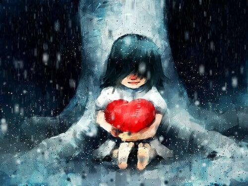 Chica abrazando a un corazón