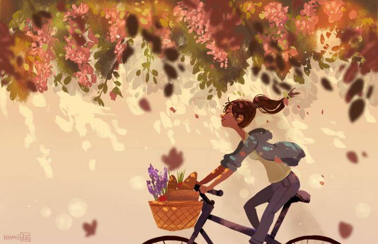 Chica en bici disfrutando
