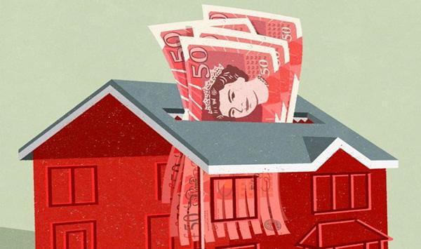 hucha en forma de casa con libras