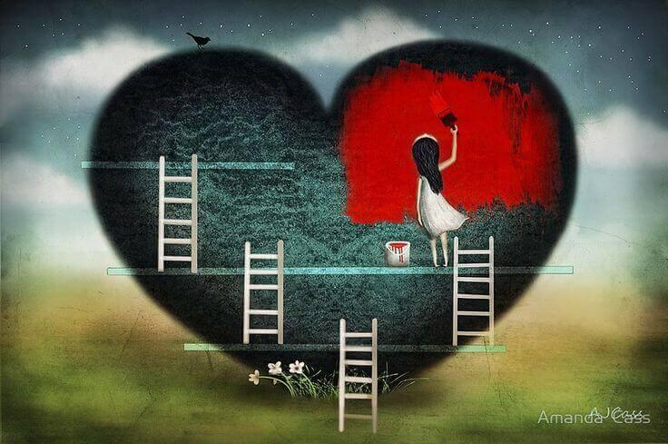 Niña pintando corazón rojo representando media naranja