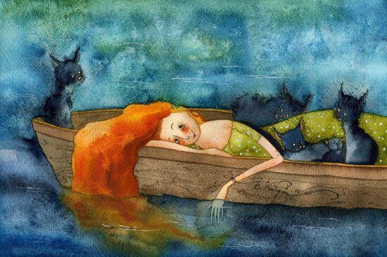 Mujer en un barco con gatos