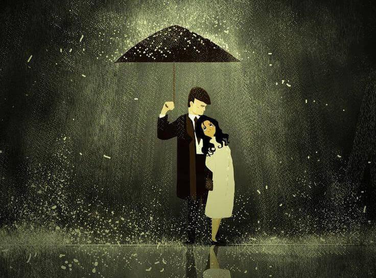 Pareja con un paraguas bajo la lluvia y enfocada por una luz