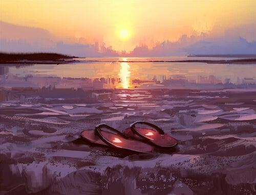 Zapatillas de un caminante en la playa
