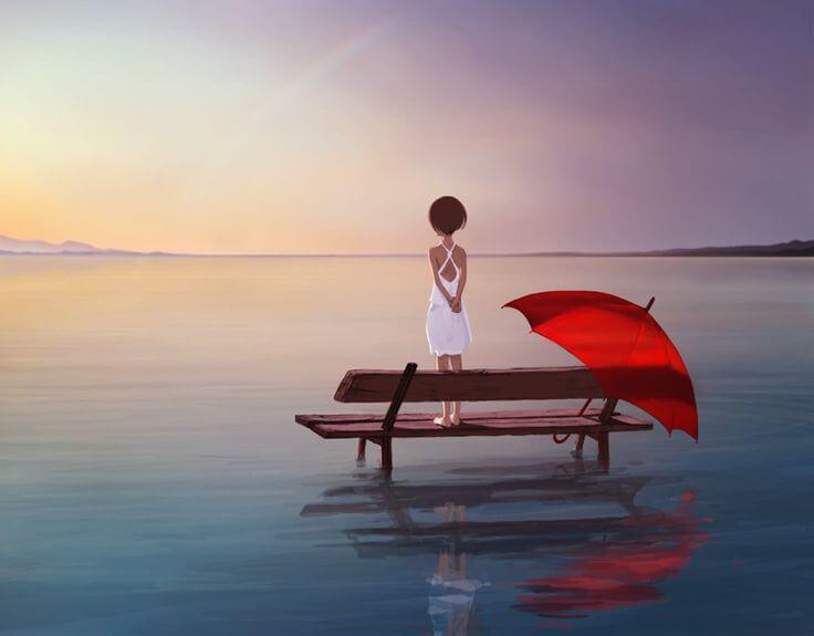 Mujer mirado al lago con un paraguas rojo