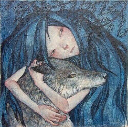 Mujer abrazando a un lobo pensando en la magia