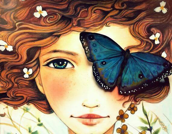 Mujer con mariposa en el ojo