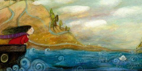 Mujer mirando las olas