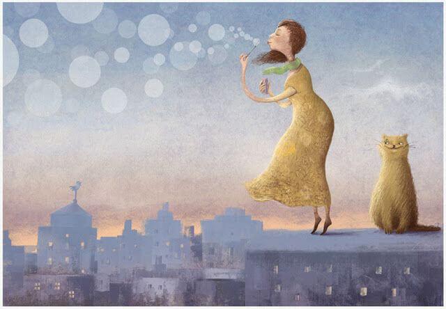 Mujer soplando pompas de jabón
